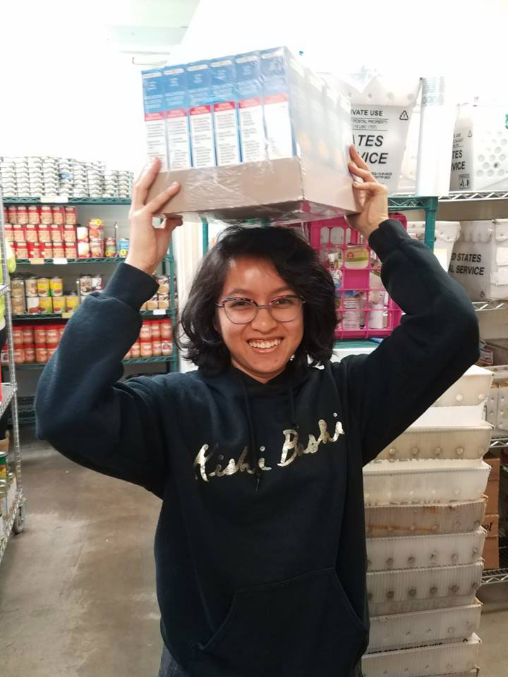 Volunteer with box on head